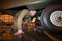 An engineer, Jack Braithwaite, examines a British Merlin helicopter in a heated hangar in the Arctic. Joint Helicopter Command trains in Bardufoss, Norway every year.  <br /> <br /> 845 Naval Air Squadron is a squadron of the Royal Navy's Fleet Air Arm. Part of the Commando Helicopter Force, it is a specialist amphibious unit operating the Leonardo Commando Merlin Mk3 helicopter and provides troop transport and load lifting support to 3 Commando Brigade Royal Marines.<br /> <br /> ©Fredrik Naumann/Felix Features