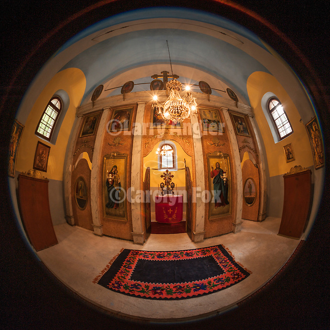 Interior and ikonstas of Sveto Vaznesenje Serbian Orthodox Church built of stone in the late 17th century.<br /> <br /> Mokra Gora is one village but three mountains, one village but two churches-one in Krsanj, another in the centre of Mokra Gora.The first had been burnt down three times by the Turke and people of Mokra Gora persistently erected it from the ashes.According to oral tradition the church of Sveto Vaznesenje had been built at the end of 17th century, before the great migration of the Serbs, on a very hidden spot near the river Beli Rzav, surrounded by very high rocks on both sides. After the three burnings of the church in Krsanj, people of this village built a stone church that still esist and there is a valuable iconostasis from<br /> the year 1849 with the icons painted in the same year. It's the icon of Jesus Christ, the big archpriest on the throne and the icon of Mother of God with Christ on the throne. People of Mokra Gora had been trying to build a church in Mokra Gora since 1876.<br /> It is reported that the icone of Holly Mother of God had been brought from Krsanje to Mokra Gora three times, but all over again it returned by itself to Krsanje to the site of a fire, and not until 1945 Mokrogorci built the church and erected the paris home.