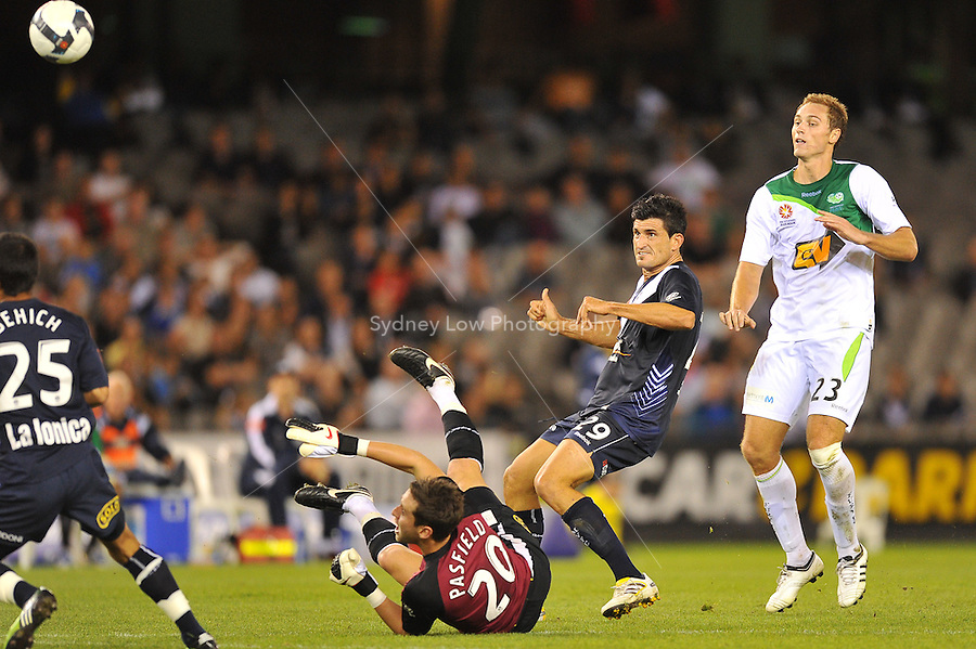 MELBOURNE, AUSTRALIA - FEBRUARY 5, 2010: Nik Mrdja from Melbourne Victory shoots for goal in round 26 of the A-league match between Melbourne Victory and North Queensland Fury at Etihad Stadium on February 5, 2010 in Melbourne, Australia. Photo Sydney Low www.syd-low.com