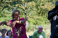 Woman dancing to Somali music, Bantu harvest festival, Maine