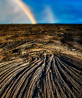 Rainbow over lava field. Hawaii Island