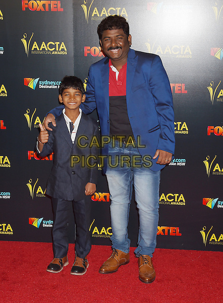 LOS ANGELES, CA - JANUARY 06: Actor Sunny Pawar (L) and his father arrive at the 6th AACTA International Awards at Avalon Hollywood on January 6, 2017 in Los Angeles, California.<br /> CAP/ROT/TM<br /> &copy;TM/ROT/Capital Pictures