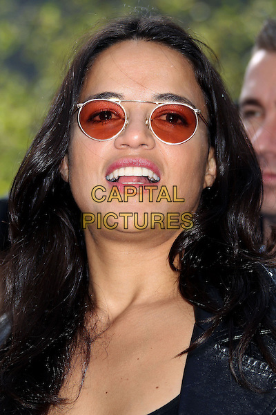Michelle Rodriguez<br /> &quot;Turbo&quot; Party And Pop-Up Concert During E3 Gaming Convention held at Nokia Theatre L.A. Live, Los Angeles, California, USA.<br /> June 12th, 2013<br /> headshot portrait leather jacket black sunglasses shades <br /> CAP/ADM/RE<br /> &copy;Russ Elliot/AdMedia/Capital Pictures