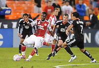Portland Timbers forward Kalif Alhassan (11) shield the ball against D.C. United forward Dwayne De Rosario (7). D.C. United tied The Portland Timbers 1-1at RFK Stadium, Wednesday October 19, 2011.