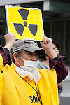 """March 10, 2013, Tokyo, Japan -  Anti-nuclear protester holds placards during a """"Zero Nukes"""" rally in downtown Tokyo. The day before the second-year anniversary of the Great East Japan Earthquake and TEPCO Fukushima Daiichi nuclear power plant accident of March 11, 2011. The rally is held by Metropolitan Coalition Against Nukes which was formed in September 2011. (Photo by Rodrigo Reyes Marin/AFLO).."""
