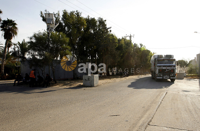 A trucks loaded with supplies enters the Gaza Strip from Israel through the Kerem Shalom crossing in Rafah in the southern Gaza Strip on November 5, 2014. UN peace envoy Robert Serry announced on November 4 that the temporary reconstruction mechanism for the war-torn Palestinian territory had begun operations, under the auspices of the newly formed Palestinian unity government, noting the urgency in providing cement and other materials to tens of thousands of damaged homes in Gaza ahead of winter. Photo by Abed Rahim Khatib