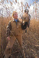 Woman Falconer, holding a Red-tailed Hawk