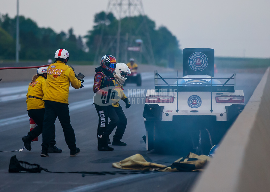 Jun 2, 2018; Joliet, IL, USA; NHRA funny car driver Courtney Force (left) runs to the aid of her father John Force after he crashed into the wall during qualifying for the Route 66 Nationals at Route 66 Raceway. Force would walk away from the crash. Mandatory Credit: Mark J. Rebilas-USA TODAY Sports