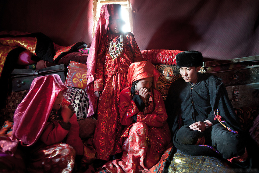 The morning after the wedding - 15 year old Bibi Zohra (centered, seated) and her husband (in black) and the chaperon sisters. Couples are expected to procreate as soon as they are married...Wedding celebration at Kitshiq Aq Jyrga...Trekking through the high altitude plateau of the Little Pamir mountains (average 4200 meters) , where the Afghan Kyrgyz community live all year, on the borders of China, Tajikistan and Pakistan.