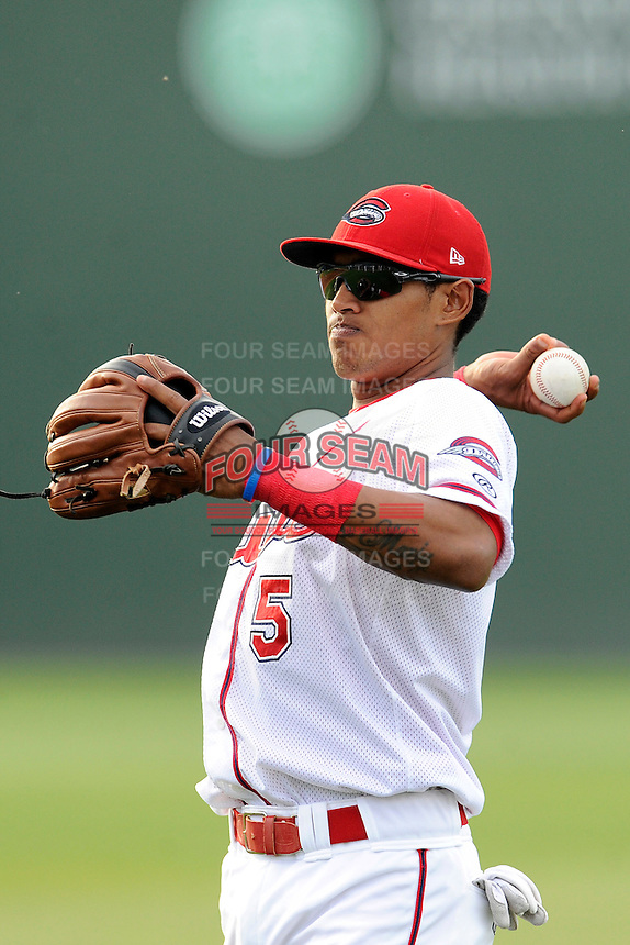 Infielder Deiner Lopez (5) of the Greenville Drive warms up before a game against the Lexington Legends on Tuesday, April 14, 2015, at Fluor Field at the West End in Greenville, South Carolina. Lexington won, 5-3. (Tom Priddy/Four Seam Images)