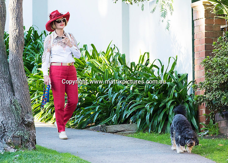 20 APRIL 2016 SYDNEY AUSTRALIA<br /> WWW.MATRIXPICTURES.COM.AU<br /> <br /> EXCLUSIVE PICTURES<br /> <br /> Gai Waterhouse pictured in an eccentric modern day cowboy outfit doing a bit of multi tasking with a leg stretch and a phone call. Funny old Gai.