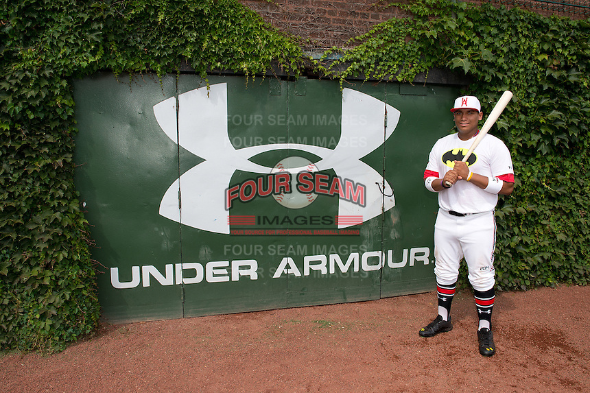 Josh Naylor (10) of St. Joan of Arc High School in Mississauga, Ontario, Canada poses for a photo during practice before the Under Armour All-American Game on August 16, 2014 at Wrigley Field in Chicago, Illinois.  (Mike Janes/Four Seam Images)