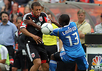 WASHINGTON, D.C. - AUGUST 19, 2012:  Nick DeLeon (18) of DC United goes for the bal lwith Michael Lahoud (13) of the Philadelphia Union during an MLS match at RFK Stadium, in Washington DC, on August 19. The game ended in a 1-1 tie.