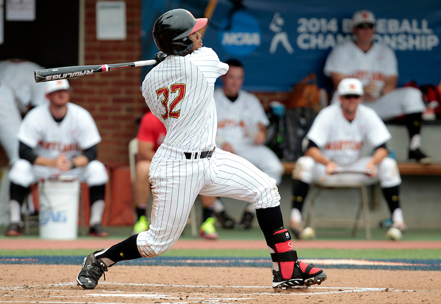 Maryland catcher Kevin Martir (32) hits a single in the third inning of an NCAA college baseball tournament super regional game against Virginia in Charlottesville, Va., Sunday, June 8, 2014.  (AP Photo/Andrew Shurtleff)