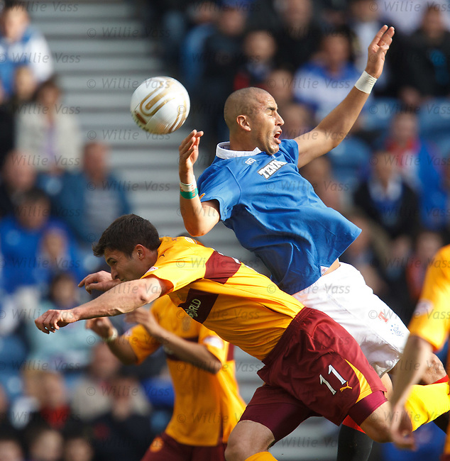 Madjid Bougherra falls over over John Sutton as he goes for the ball