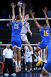 LOS ANGELES - MAY 5:  Kyle Ensing #5 of the Long Beach State 49ers hits the ball against Jake Arnitz #15 and Daenan Gyimah #16 of the UCLA Bruins during the Division 1 Men's Volleyball Championship on May 5, 2018 at Pauley Pavilion in Los Angeles, California. The Long Beach State 49ers defeated the UCLA Bruins 3-2. (Photo by John W. McDonough/NCAA Photos via Getty Images)