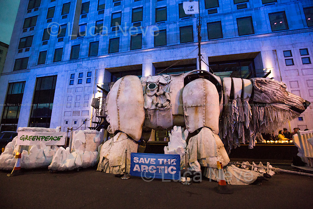 London, 20/09/2015. Today a candle-light vigil was held outside the Shell HQ in Waterloo to protest against the oil giant plan to drill the Arctic to extract oil. The demonstration was also attended by &quot;Aurora&quot;, a giant (the size of a Double Decker bus) people-powered polar bear made by Greenpeace activists. From the organiser Facebook page: &lt;&lt;The Arctic sea ice is melting. Global temperatures are rising. And yet Shell wants to drill in the Arctic's pristine environment for more of the oil that caused the ice to melt in the first place. More than 7 million people have joined the movement to save the Arctic. Two weeks ago, Aurora, a giant polar bear representing the Arctic and the strength of our movement visited Shell's HQ demanding that Shell stop drilling in her home. Two weeks down the line, Shell still refuses to pull out of the Arctic or engage in a conversation to hear out what millions have to say. Earlier this week, we heard that this year was the fourth lowest sea ice minimum on record. All the four lowest on record have happened since 2007 and scientists are telling us that this is a clear indicator of climate change. [&hellip;] live music with folk band Ys to warm your ears. [&hellip;]&gt;&gt;.<br /> <br /> For more information please click here: http://on.fb.me/1NFQuv6 &amp; https://www.savethearctic.org/
