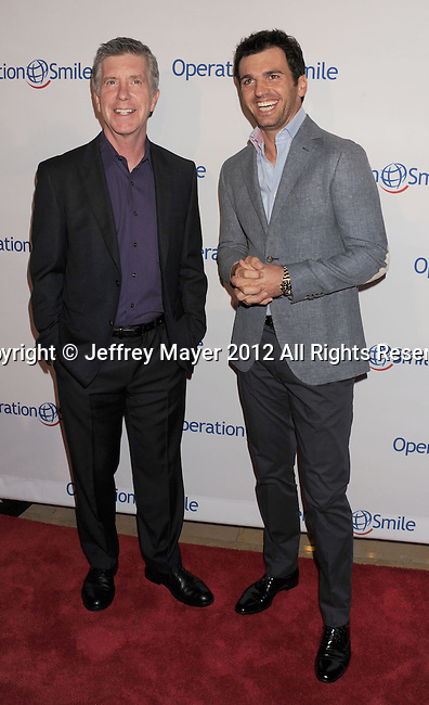 BEVERLY HILLS, CA - SEPTEMBER 28: Tom Bergeron and Tony Dovolani attend Operation Smile's 30th Anniversary Smile Gala - Arrivals at The Beverly Hilton Hotel on September 28, 2012 in Beverly Hills, California.