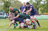 Joe Atkinson of London Scottish is tackled during the Greene King IPA Championship match between London Scottish Football Club and Nottingham Rugby at Richmond Athletic Ground, Richmond, United Kingdom on 15 April 2017. Photo by David Horn.