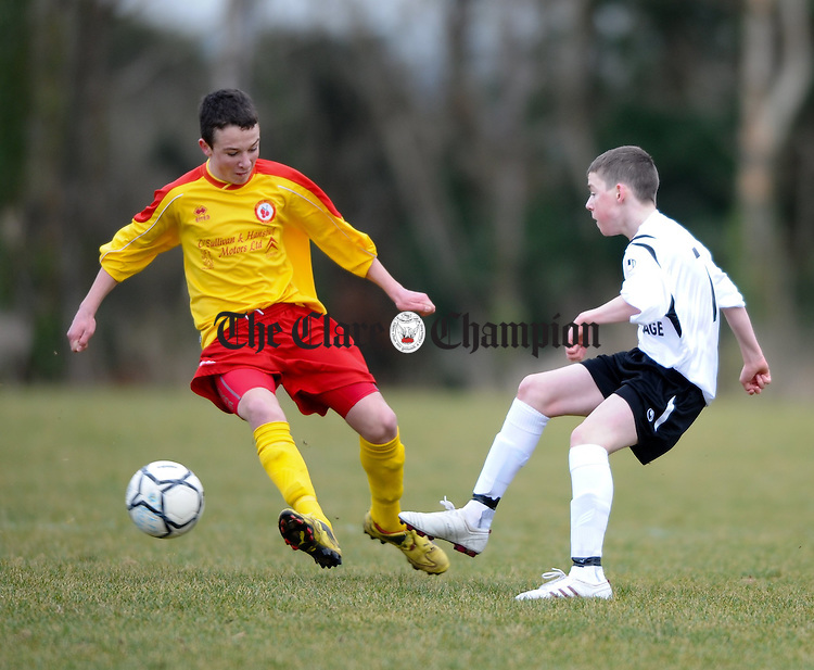 Avenue's Paddy O Malley closes in on Kilmacrennan's Chris Dillon during their U-14 National Cup game at Lees Road. Photograph by John Kelly.