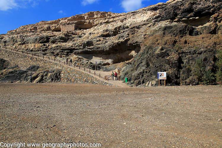 Start of cliff top coastal path on beach at the coastal village of Ajuy, Fuerteventura, Canary Islands, Spain