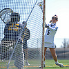 Jacqueline Jahelka #5 of Adelphi University scores a goal during an NCAA Division II women's lacrosse game against Merrimack at Motamed Field in Garden City, NY on Saturday, April 8, 2017. She recorded two goals and five assists in top-ranked Adelphi's 19-1 win.