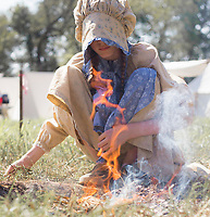 NWA Democrat-Gazette/CHARLIE KAIJO Gwen Crawford of Joplin, 11, sits by a fire, Friday, October 4, 2019 at a field north of Pea Ridge along the Missouri border in Pea Ridge.<br /> <br /> Members of the Trans Mississippi Brigade set up camp for visitors to see life as it was in the 1860s in a battle camp. The camp will be open from 9 a.m. to 9 p.m. Friday through Sunday. There will be two battle reenactments — one at 1 p.m. Saturday and the other at 1 p.m. Sunday. The battle on Saturday will reenact the Battle of Elkhorn that was won by the Confederates. The battle on Sunday will be Welfley's Knoll and the Union will win.
