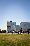 "MASSACHUSETTS, Boston, College Student playing Soccer infront of Simmons Hall, ""The Sponge"" on MIT campus."