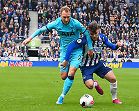Christian Eriksen of Tottenham Hotspur and Aaron Connolly of Brighton and Hove Albion vie for the ball during Brighton & Hove Albion vs Tottenham Hotspur, Premier League Football at the American Express Community Stadium on 5th October 2019