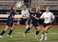 DOYLESTOWN, PA - OCTOBER 6: Council Rock South's Julie Rehb #3 kicks the ball as Central Bucks West's Allie Walsh #25 looks on at Central Bucks West October 6, 2014 in Doylestown, Pennsylvania. (Photo by William Thomas Cain/Cain Images)