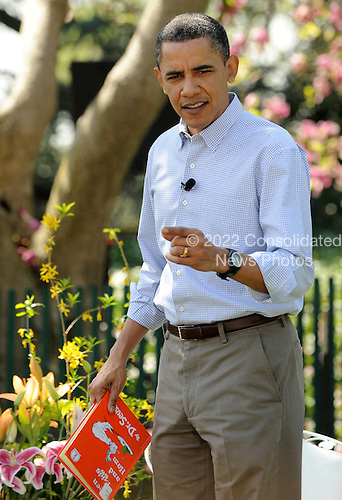 """United States President Barack Obama arrives to read Dr. Suess' """"Green Eggs and Ham"""" on the South Lawn during the White House Easter Egg Roll in Washington on Monday, April 5, 2010..Credit: Roger L. Wollenberg / Pool via CNP"""