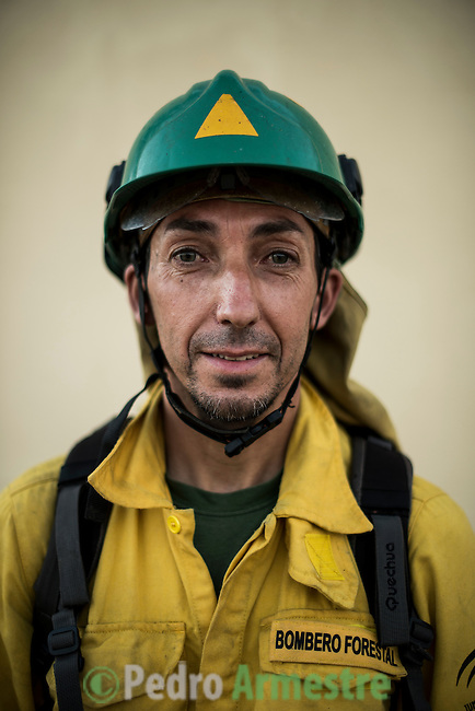 Francisco Guerrero. The firefighter from the BRICA Málaga 703, the Andalusian Service firefighting (INFOCA),  posses after a wildfire in Los Barrios near Cadiz on July 25, 2015. © Pedro ARMESTRE