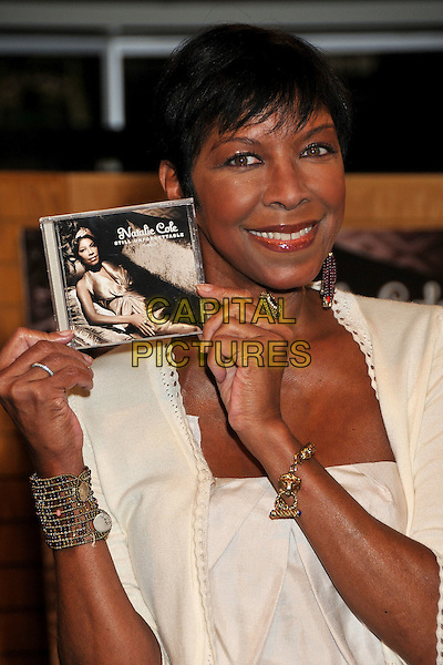 NATALIE COLE <br /> Natalie Cole &quot;Still Unforgettable&quot; CD Signing at Borders Bookstore, Westwood, California, USA, <br /> 28 October 2008 <br /> half length holding cd red beaded earrings  cream <br /> CAP/ADM/BP<br /> &copy;Byron Purvis/Admedia/Capital PIctures
