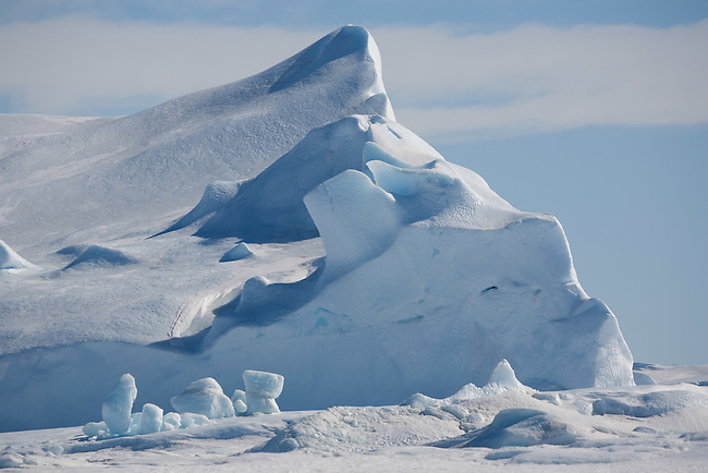 Small well weathered iceberg frozen into the sea ice at Snow Hill Island. Antarctica
