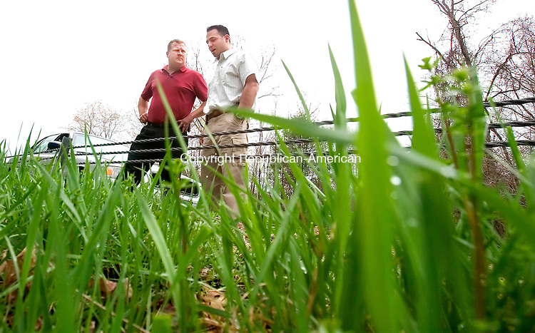 HARWINTON, CT. 03 May 2007-050307SV05--Detective Richard Baxter and Sgt. Michael Ponzillo of the Waterbury Police investigate a cold cases of three women found on Valley Road in Harwinton, exit 41 off Route 8.<br /> Steven Valenti Republican-American