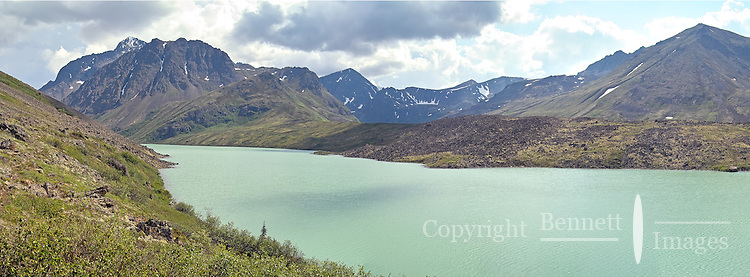 A cloud passes overr the green waters of Eagle Lake, tucked in the Chugach Mountains outside Anchorage, Alaska.