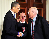 Washington, D.C. - March 23, 2010 -- United States President Barack Obama, left, shakes hands with U.S. Representative John Dingell (Democrat of Michigan), right, as he prepares to sign the version of the health care bill that was passed by the U.S. House of Representatives in the East Room of the White House in Washington, D.C. on Tuesday, March 23, 2010.  Dingell is the longest-serving member of the U.S. House and has been fighting for health care reform for the past half-century..Credit: Ron Sachs / CNP.(RESTRICTION: NO New York or New Jersey Newspapers or newspapers within a 75 mile radius of New York City)