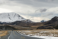 Road through high country near Porters Pass in winter, Canterbury, New Zealand