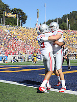 Ohio State Buckeyes tight end Jeff Heuerman (86) congratulates Ohio State Buckeyes wide receiver Devin Smith (9) after Smith scored a touchdown on a 91-yard pass from quarterback Kenny Guiton (13)  during the first quarter of  the NCAA football game at Memorial Stadium in Berkeley, California on Sept. 14, 2013. (Adam Cairns / The Columbus Dispatch)