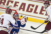 Bill Arnold (BC - 24), Connor Hellebuyck (UML - 37), Kevin Hayes (BC - 12) - The Boston College Eagles defeated the visiting University of Massachusetts Lowell River Hawks 3-0 on Friday, February 21, 2014, at Kelley Rink in Conte Forum in Chestnut Hill, Massachusetts.