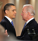 Washington, D.C. - March 23, 2010 -- United States Vice President Joseph Biden, right and U.S. President Barack Obama embrace during the ceremony where the President signed the version of the health care bill that was passed by the U.S. House of Representatives in the East Room of the White House in Washington, D.C. on Tuesday, March 23, 2010..Credit: Ron Sachs / CNP.(RESTRICTION: NO New York or New Jersey Newspapers or newspapers within a 75 mile radius of New York City)