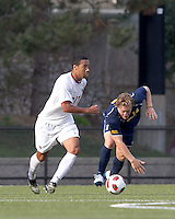 Boston College forward Charlie Rugg (17) dribbles as Quinnipiac University defender Matthew Rothbart (14) regains his footing. Boston College defeated Quinnipiac, 5-0, at Newton Soccer Field, September 1, 2011.