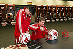 Wisconsin Badgers student managers Alex Graf, left, and Zack DuBois work on football helmets in the team locker room prior to the 2012 Rose Bowl NCAA football game against the Oregon Ducks in Pasadena, California on January 2, 2012. The Ducks won 45-38. (Photo by David Stluka)