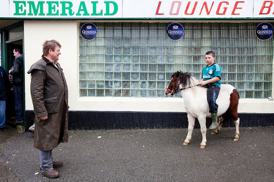 4/10/2010. Matt Walsh from Clare and Dany O Shea aged 9 from Cork with his pony Sam are pictured outside the Emerald bar at the Ballinasloe Horse Fair, Ballinasloe, County Galway, Ireland. Picture James Horan