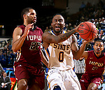 BROOKINGS, SD - FEBRUARY 6:  Deondre Parks #0 from South Dakota State drives past Marcellus Barksdale #22 from IUPUI during their game Saturday evening at Frost Arena in Brookings. Photo by Dave Eggen/Inertia)