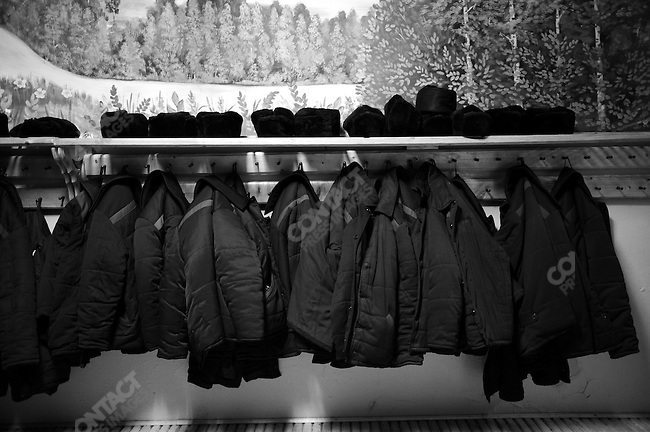 The hats and coast of prisoners arranged neatly outside the prison dining room during lunch at prison colony #7 outside of Novgorod in the Novgorod region south of St. Petersburg, Russia, December 15, 2008