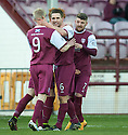Arbroath's Bobby Linn (7) celebrates with Jack Smith (9) and Mark Whatley (6) after he scores their first goal.