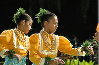 Two girls in dancing hula. Profile view.