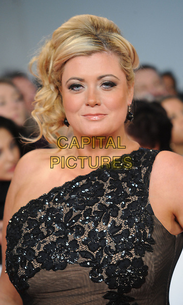 Gemma Collins of TOWIE.arriving at the National TV Awards 2012 at the O2 Arena, London, England, UK, .25th January 2012..NTA NTAs arrivals  portrait headshot one shoulder black lace .CAP/WIZ.© Wizard/Capital Pictures.