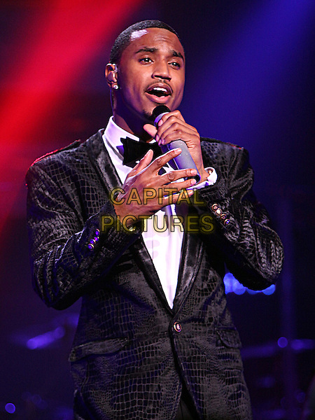Trey Songz (Tremaine Aldon Neverson).Singer-songwriter, rapper, record producer and actor Trey songz performed for a sold-out crowd at the historic Fox Theatere in downtown Atlanta, Atlanta, GA, USA,.March 8th 2012..music live on stage concert gig half length microphone black bow tie tuxedo tux singing hand .CAP/ADM/DH.©Dan Harr/AdMedia/Capital Pictures.